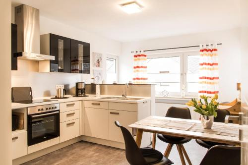 A kitchen or kitchenette at Haus Burgfee