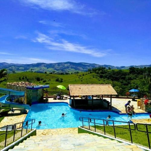 The swimming pool at or near Alpes Fazenda Hotel