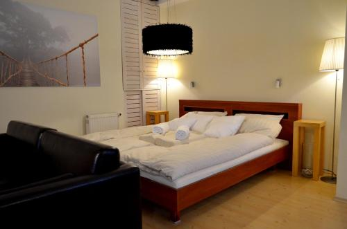 A bed or beds in a room at Luxury Yoga Apt next to Buda Castle