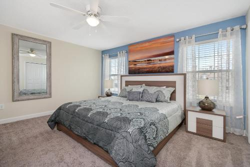 A bed or beds in a room at Four Bedrooms close to Disney w Pool 4898