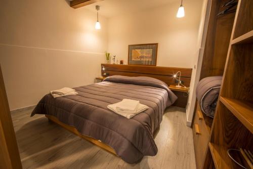 NOVA DOMUS S. PAOLO tesisinde bir odada yatak veya yataklar