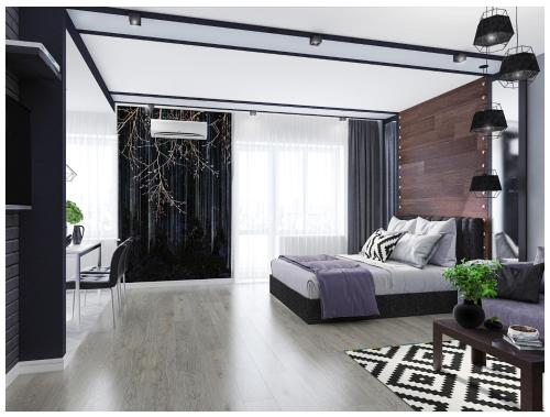 A bed or beds in a room at Design Apartment Center Olimpiyska