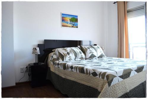 Cama o camas de una habitación en Apartamentos del Centro