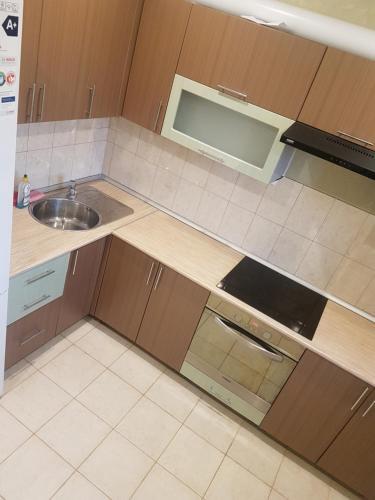 Кухня или мини-кухня в Home-Hotel Apartament Comfort+
