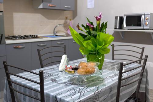A kitchen or kitchenette at Casa Vacanze Del Core