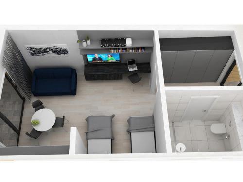 Télévision ou salle de divertissement dans l'établissement Black Beach Suites