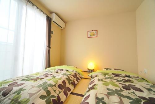 A bed or beds in a room at Apartment Hotel Mille Glycine II