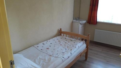 A bed or beds in a room at de Zandput 46