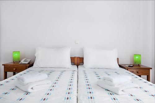 A bed or beds in a room at Sunrise Paros