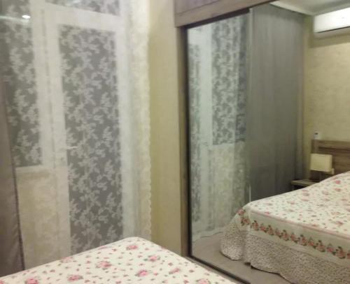 Lova arba lovos apgyvendinimo įstaigoje Batumi Seaview Apartment