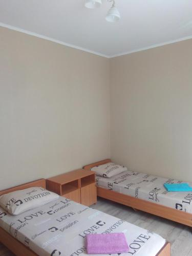 A bed or beds in a room at Guest House Bereg Morya