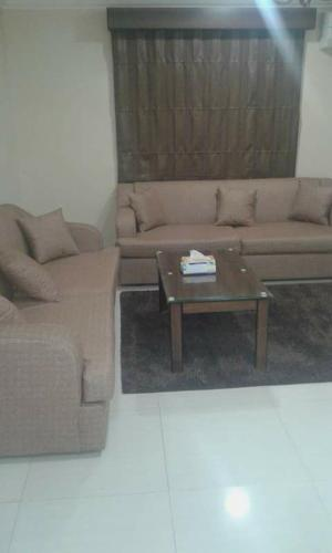 A seating area at Qimam Saba Furnished Units (for families only)
