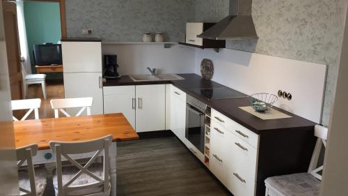 A kitchen or kitchenette at Historical Apartment