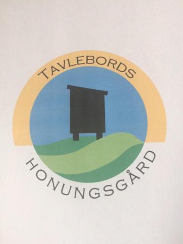 Logotypen eller skylten för semesterhuset