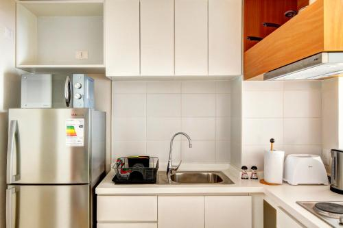 Una cocina o zona de cocina en Rukaza Lastarria Apartments