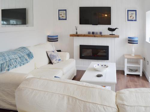 A television and/or entertainment center at Coastguards Hideaway
