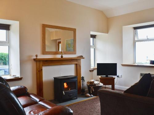 A seating area at Barrmains Cottage