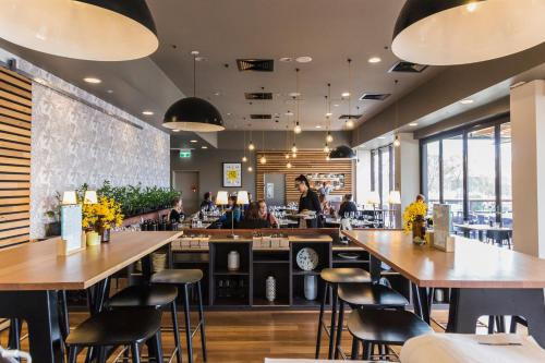 A restaurant or other place to eat at Abode Woden