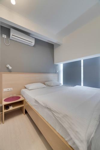Кровать или кровати в номере Минима Аэропорт