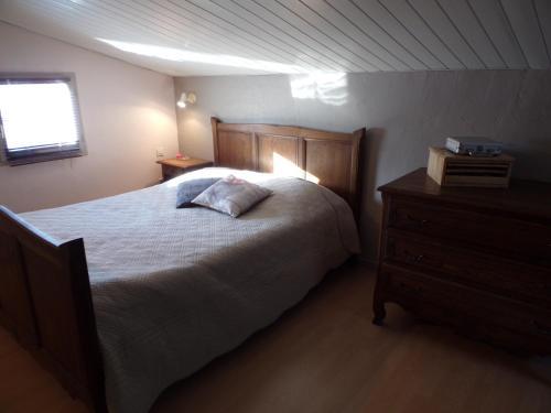 Un ou plusieurs lits dans un hébergement de l'établissement Gite Campagnolle