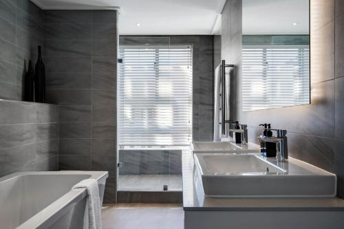 A bathroom at The Penthouse Collection