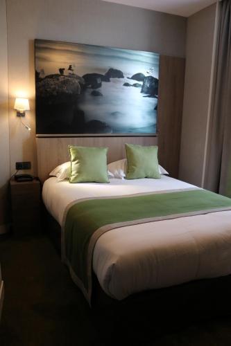 Un ou plusieurs lits dans un hébergement de l'établissement Le Mouton Blanc