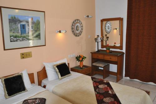 Una cama o camas en una habitación de Sun And Sea Apartments