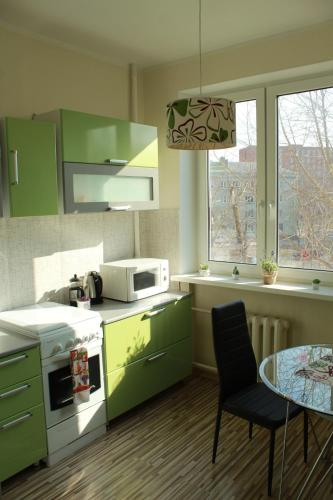 A kitchen or kitchenette at Happy Day