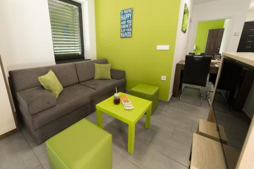 Predel za sedenje v nastanitvi Apartmaji Banonia Travniška rosa