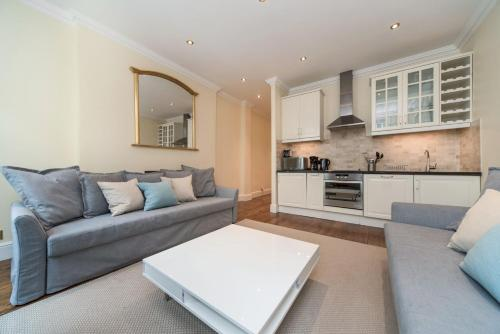 A seating area at Piccadilly Exclusive Apartments