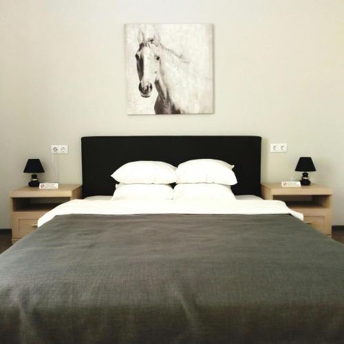 Tempat tidur dalam kamar di Bed&Breakfast Baznicas 33