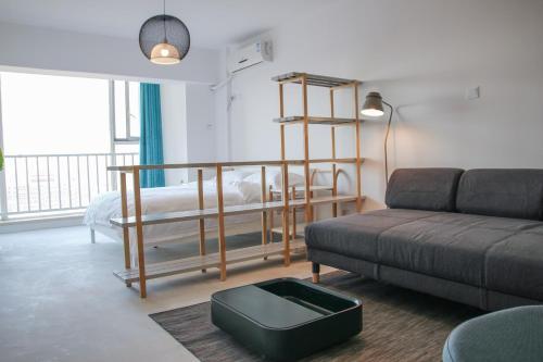 Гостиная зона в Tea Tree Apartment