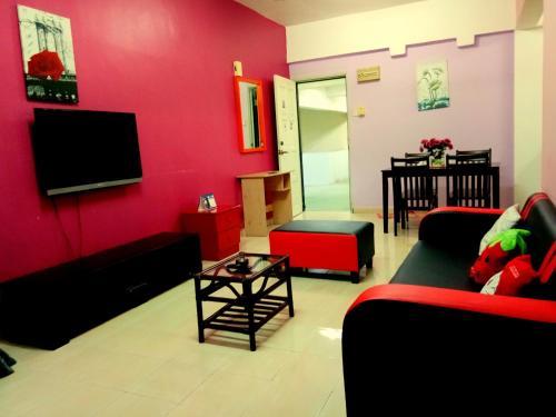 En tv och/eller ett underhållningssystem på JC Apartment Sunshine Bay Resort Port Dickson