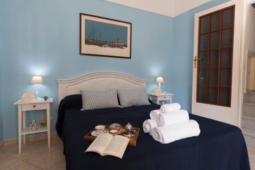 A bed or beds in a room at La casa di Giò