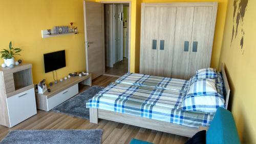A bed or beds in a room at Agria Residence