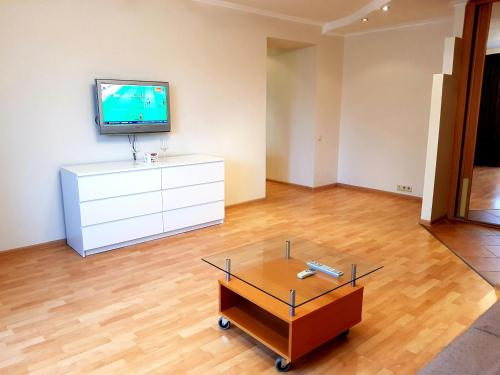 A television and/or entertainment center at Apartment on Karmanitskiy