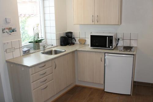 Een keuken of kitchenette bij Odense Apartments