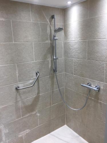 Een badkamer bij Check-Inn 1