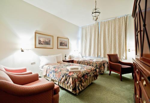 Lova arba lovos apgyvendinimo įstaigoje Miodosytnia Aparthotel