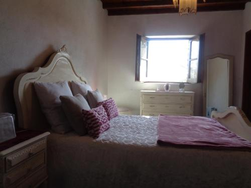 A bed or beds in a room at Sossego