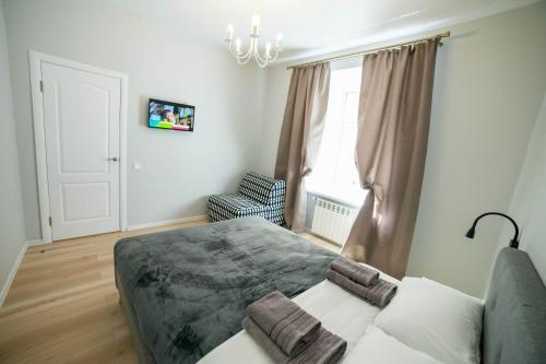 Łóżko lub łóżka w pokoju w obiekcie Vicheva apartments