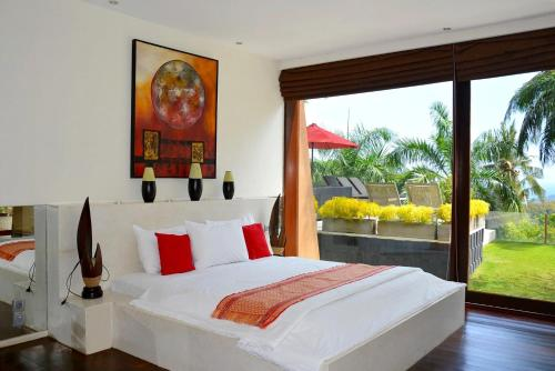 A bed or beds in a room at Villa Tiara