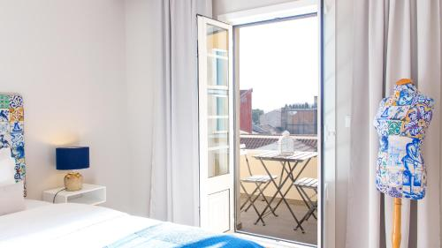 A balcony or terrace at Praça 44 - Boutique Apartments
