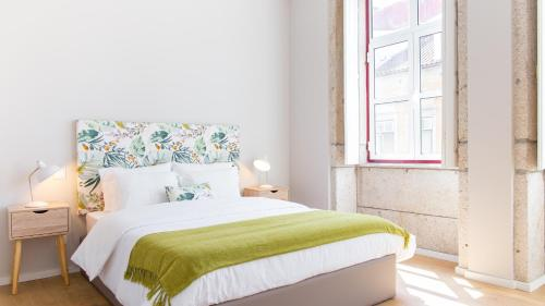 A bed or beds in a room at Praça 44 - Boutique Apartments