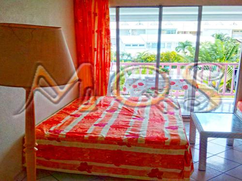 A bed or beds in a room at Marina Quality Stay Guadeloupe