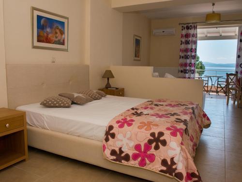 Posteľ alebo postele v izbe v ubytovaní Porto Xronia