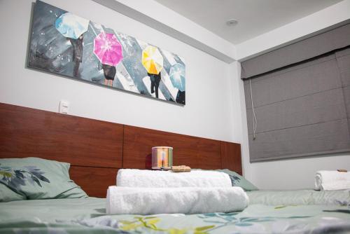 Cama o camas de una habitación en Cusco Cozy Apartment