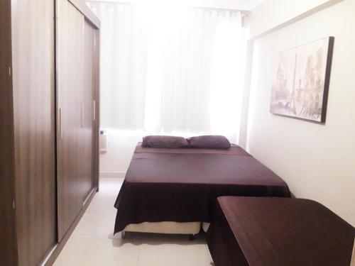 A bed or beds in a room at Apartamento Balneário Camboriú