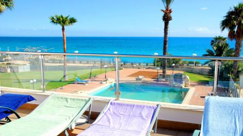 A view of the pool at Pallinion Apartment Beachfront or nearby