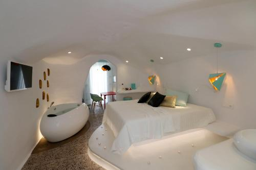 A bed or beds in a room at Naxos Cave Suites